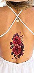 Tatuaje temporal flor de color púrpura